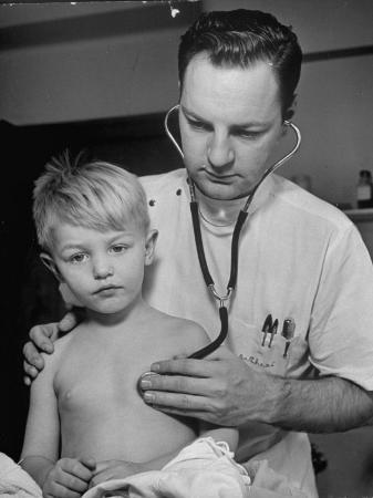 alfred-eisenstaedt-intern-at-minneapolis-general-hospital-using-stethoscope-to-examine-boy-recovering-from-pneumonia