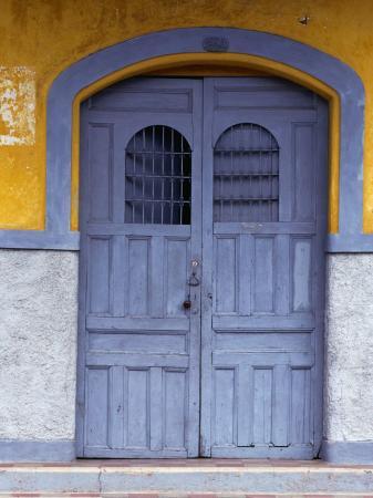 alfredo-maiquez-a-smokey-grey-wooden-door-of-a-painted-colonial-house-granada-granada-nicaragua