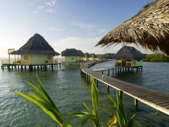 alfredo-maiquez-wooden-walkways-leading-out-to-cabins-at-punta-caracol-hotel