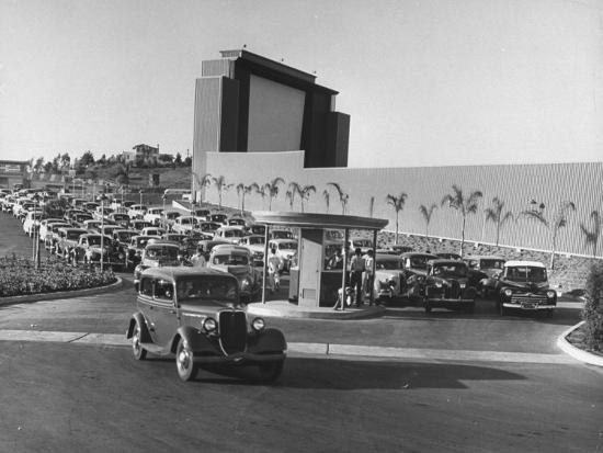 allan-grant-cars-pouring-into-main-entrance-to-rancho-drive-in-theater-lot-boys-amongst-cars-selling-tickets