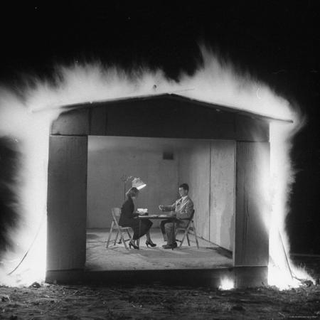 allan-grant-mr-and-mrs-andrew-andeck-nonchalantly-playing-double-solitaire-while-safelite-garage-flames