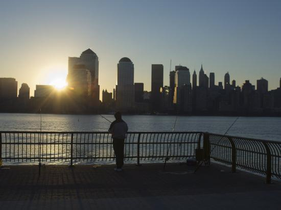 amanda-hall-fisherman-fishing-from-a-jersey-city-pier-at-dawn-facing-the-manhattan-skyline-jersey-city
