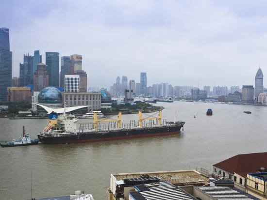 amanda-hall-large-transport-ship-and-tug-on-the-huangpu-river-that-runs-through-shanghai-china-asia