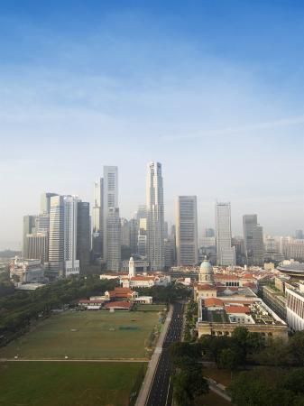 amanda-hall-singapore-city-skyline-at-dawn-with-the-padang-and-colonial-district-in-the-foreground-singapore