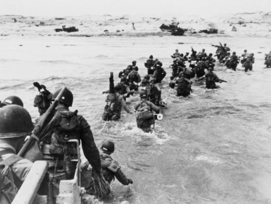 american-troops-under-enemy-fire-wading-through-the-sea-to-land-on-the-beaches-of-normandy-france