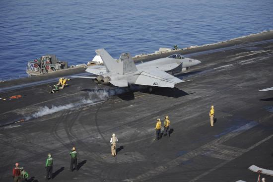 an-f-a-18e-super-hornet-launches-from-uss-nimitz