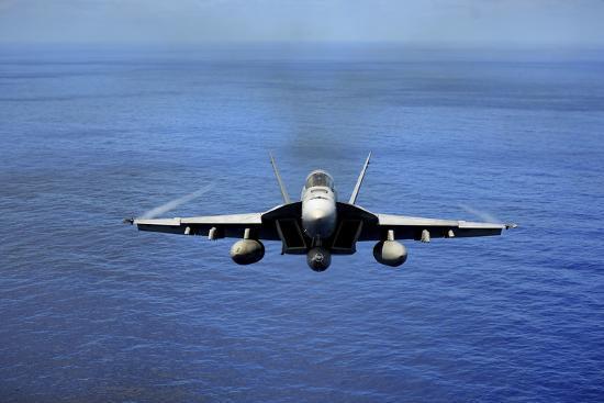 an-f-a-18e-super-hornet-over-the-pacific-ocean