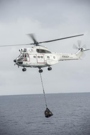 an-sa-330-puma-transport-helicopter-moves-cargo-during-a-vertical-replenishment