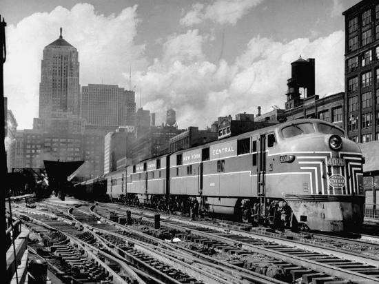 andreas-feininger-new-york-central-passenger-train-with-a-streamlined-locomotive-leaving-chicago-station