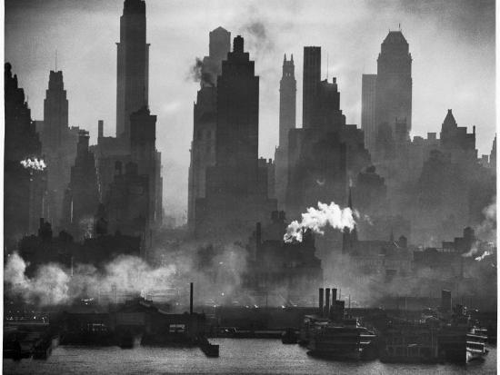 andreas-feininger-new-york-harbor-with-its-majestic-silhouette-of-skyscrapers-looking-straight-down-bustling-42nd-st