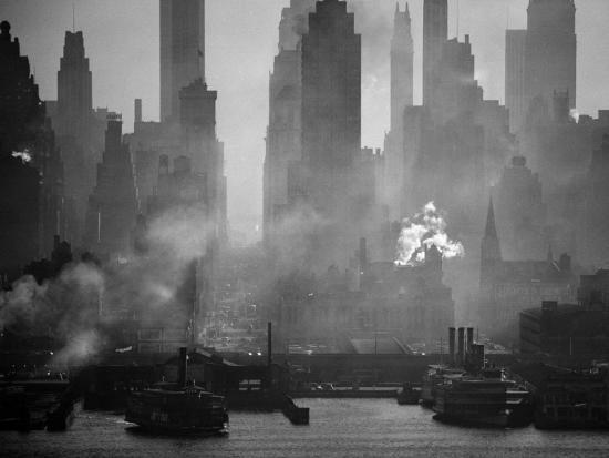 andreas-feininger-smoggy-waterfront-skyline-of-new-york-city-as-seen-from-the-shores-of-new-jersey