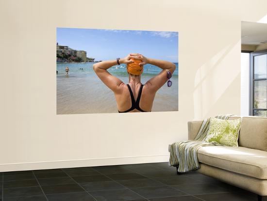 andrew-watson-woman-preparing-for-ocean-swim-at-bondi-beach