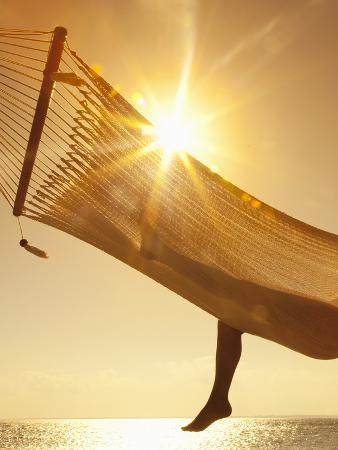 angelo-cavalli-woman-in-a-hammock-on-the-beach-florida-united-states-of-america-north-america