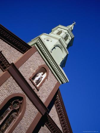 angus-oborn-statue-and-steeple-on-church-of-transfiguration-in-chinatown-new-york-city-new-york-usa