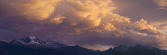 anna-miller-clouds-lit-by-setting-sun-above-rocky-mountains-ridge