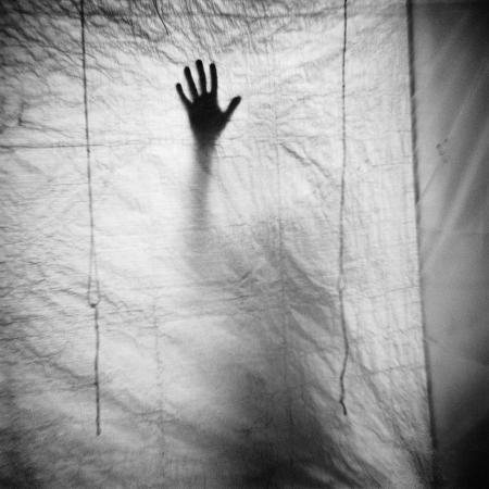 annette-fournet-shadow-of-a-hand-against-cloth