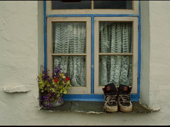 annie-griffiths-shoes-and-flowers-on-a-windowsill