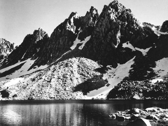 ansel-adams-kearsarge-pinnacles-partially-snow-covered-rocky-formations-along-the-edge-of-the-river