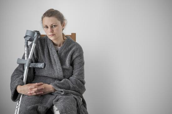 anthony-west-woman-seated-with-crutches