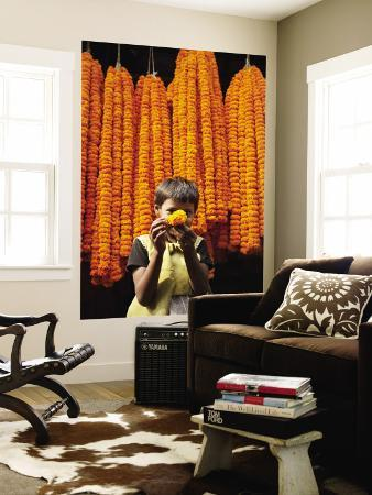 april-maciborka-little-girl-showing-off-marigold-that-she-stole-from-beautiful-strings-of-flowers