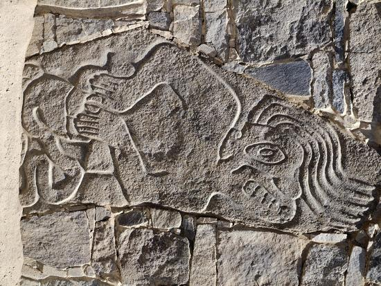 architectural-stone-engraved-with-a-dying-man-from-carro-sechin
