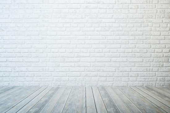 auris-empty-room-with-white-brick-wall-and-wooden-floor