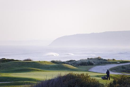 axel-schmies-greenkeeper-at-work-in-the-early-morning-praia-d-el-rey-atlantic-coast