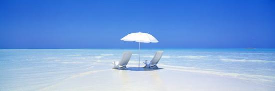beach-ocean-water-parasol-and-chairs-maldives