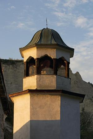 bell-tower-with-sandstone-pyramids-in-background-pirin-melnik-bulgaria