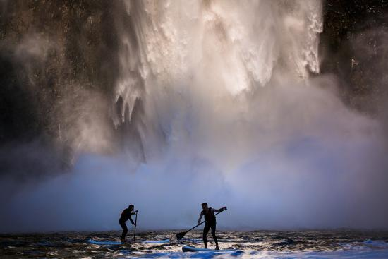 ben-herndon-a-man-and-woman-enjoy-a-beautiful-spring-afternoon-of-stand-up-paddle-at-the-base-of-palouse-falls