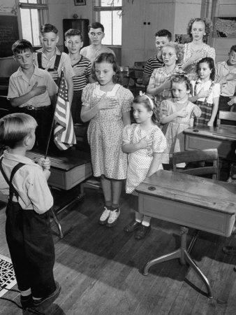 Children Reciting The Pledge Of Allegiance As A Boy Holds