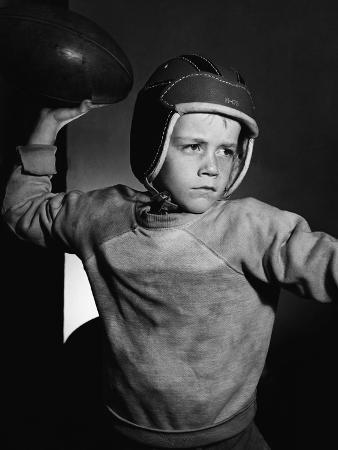 bettmann-boy-throwing-a-football