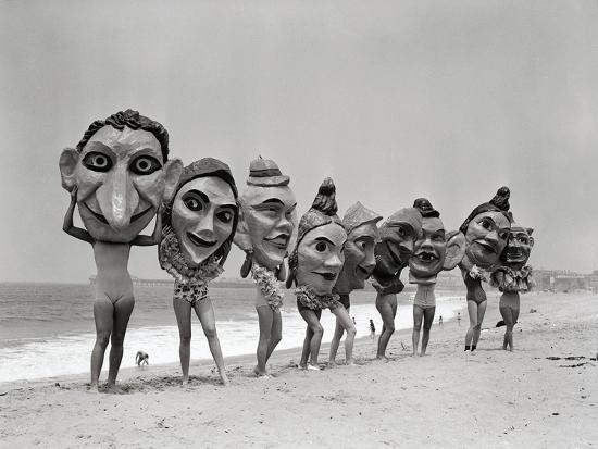 bettmann-women-holding-giant-masks