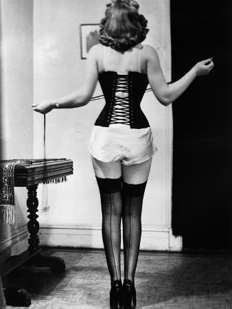 bettmann-young-woman-lacing-her-corset