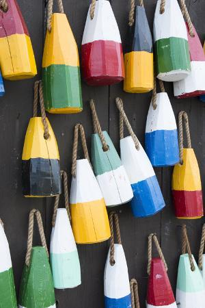bill-bachmann-bar-harbor-maine-colorful-buoys-on-wall-for-sale-and-state-specialty-souvenirs-for-lobster-traps