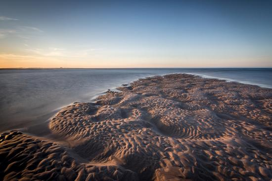 bill-ward-sand-formations-at-budle-bay-with-holy-island-castle-in-the-distance-northumberland