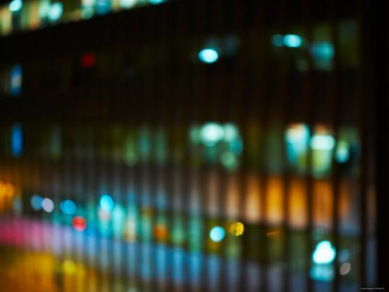 blurred-image-of-office-windows-at-night-with-illuminating-lights-in-new-york-city