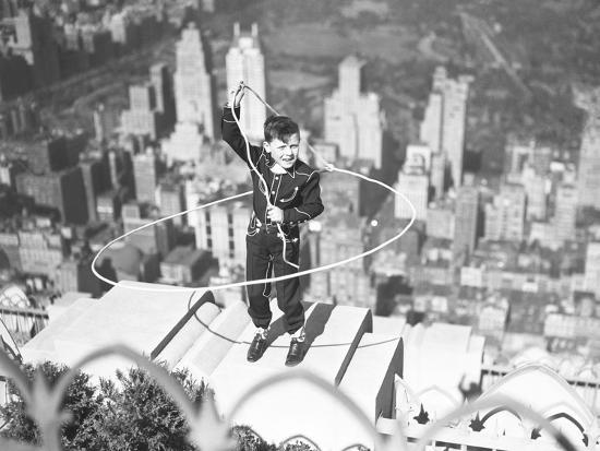 boy-on-ledge-twirling-a-lasso