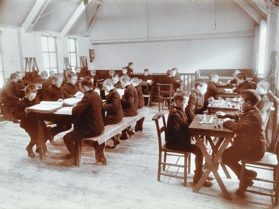 boys-playing-dominoes-and-reading-at-the-boys-home-industrial-school-london-1900