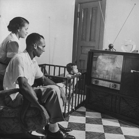 braves-player-bill-bruton-and-family-watching-tv-set-which-was-one-of-presents-in-their-apartment