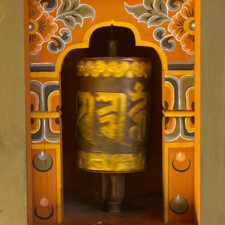 brenda-tharp-bhutan-prayer-wheel-spins-in-the-wall-of-a-temple