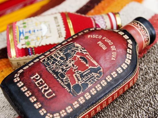 brent-winebrenner-leather-and-cloth-flask-covers-peru