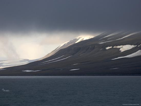 brimberg-coulson-dark-clouds-over-mountain-svalbard-islands-norway