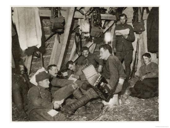 british-soldiers-off-duty-smoking-and-listening-to-an-accordion-at-the-front-somewhere-in-flanders