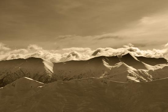 bsani-sepia-winter-mountains-at-evening-and-sunlight-clouds