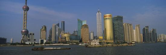 buildings-at-the-waterfront-oriental-pearl-tower-huangpu-river-pudong-shanghai-china