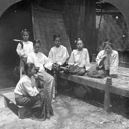burmese-women-smoking-outside-their-home-mandalay-burma-1908