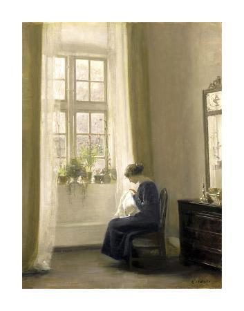 carl-holsoe-a-girl-sewing-in-an-interior