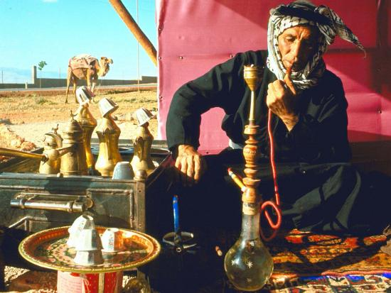 carlo-bavagnoli-arab-shepherd-smoking-his-hookah-as-he-relaxes-in-a-roadside-tea-tent