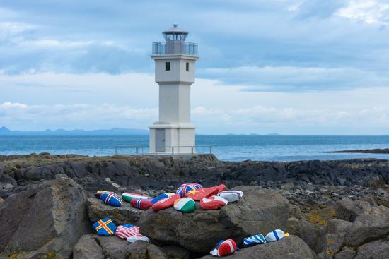 catharina-lux-akranes-at-the-lighthouse-stones-with-flag-symbol